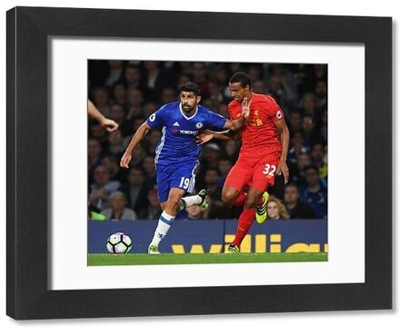 LONDON, ENGLAND - SEPTEMBER 16: Diego Costa of Chelsea holds off Joel Matip of Liverpool during the Premier League match between Chelsea and Liverpool at Stamford Bridge on September 16, 2016 in London, England