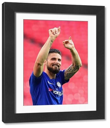 LONDON, ENGLAND - MAY 19: Olivier Giroud of Chelsea celebrates his side's victory following The Emirates FA Cup Final between Chelsea and Manchester United at Wembley Stadium on May 19, 2018 in London, England