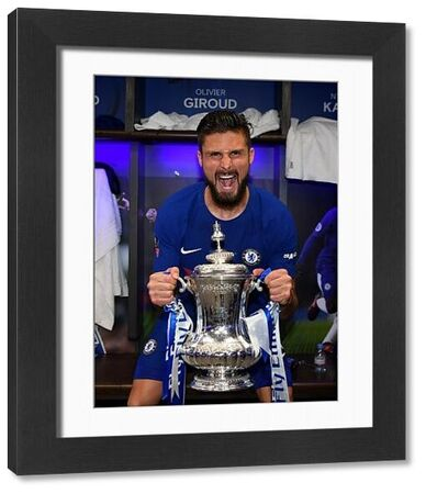 LONDON, ENGLAND - MAY 19: Olivier Giroud of Chelsea poses with the Emirates FA Cup trophy following his sides victory in The Emirates FA Cup Final between Chelsea and Manchester United at Wembley Stadium on May 19, 2018 in London, England