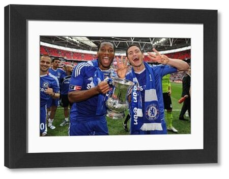 LONDON, ENGLAND - MAY 15: Frank Lampard (R) and Didier Drogba of Chelsea celebrate after winning the FA Cup sponsored by E.ON Final match between Chelsea and Portsmouth at Wembley Stadium on May 15, 2010 in London, England