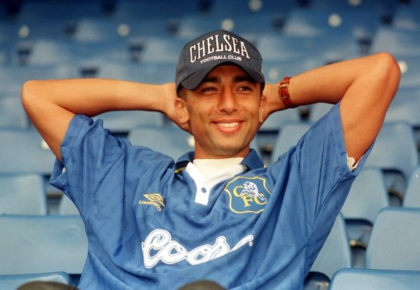 New Chelsea signing Roberto di Matteo smiles for the cameras after signing for the Stamford Bridge club from Lazio in a club-record 4.9 million deal. The 26-year-old midfielder, a member of Italy's Euro 96 squad wtih 15 caps, has signed a four-year contract