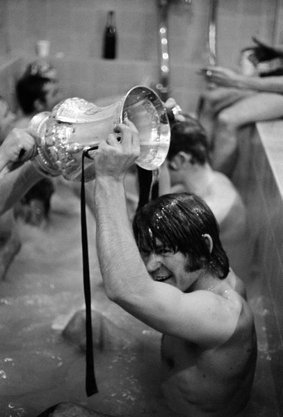 Chelsea's David Webb, scorer of the winning goal in extra time, gets a champagne shower from the FA Cup as he bathes after the Final replay at Old Trafford, Manchester. Chelsea won 2-1 in extra time