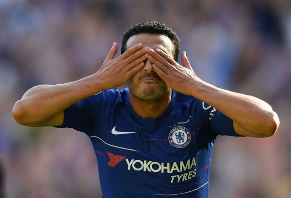 LONDON, ENGLAND - SEPTEMBER 01: Pedro of Chelsea celebrates after scoring his team's first goal during the Premier League match between Chelsea FC and AFC Bournemouth at Stamford Bridge on September 1, 2018 in London, United Kingdom