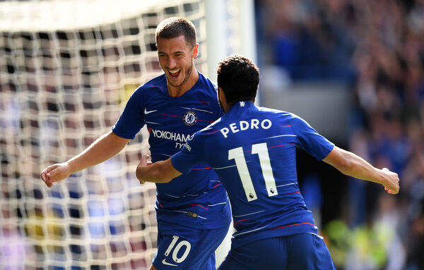 LONDON, ENGLAND - SEPTEMBER 15: Eden Hazard of Chelsea celebrates with teammate Pedro after scoring his team's second goal during the Premier League match between Chelsea FC and Cardiff City at Stamford Bridge on September 15, 2018 in London, United Kingdom