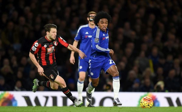 Chelsea's Willian (right) and Bournemouth's Harry Arter (left) battle for the ball