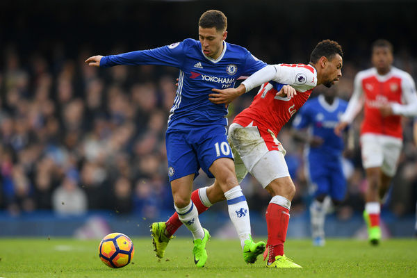 LONDON, ENGLAND - FEBRUARY 04: Eden Hazard of Chelsea battles for the ball with Francis Coquelin of Arsenal during the Premier League match between Chelsea and Arsenal at Stamford Bridge on February 4, 2017 in London, England