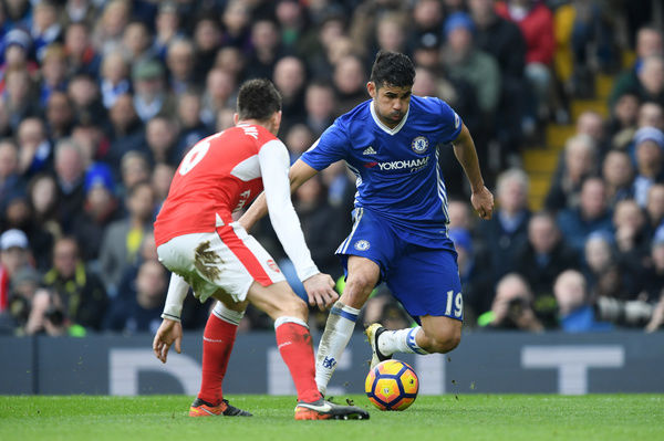 LONDON, ENGLAND - FEBRUARY 04: Diego Costa of Chelsea battles for the ball with Laurent Koscielny of Arsenal during the Premier League match between Chelsea and Arsenal at Stamford Bridge on February 4, 2017 in London, England