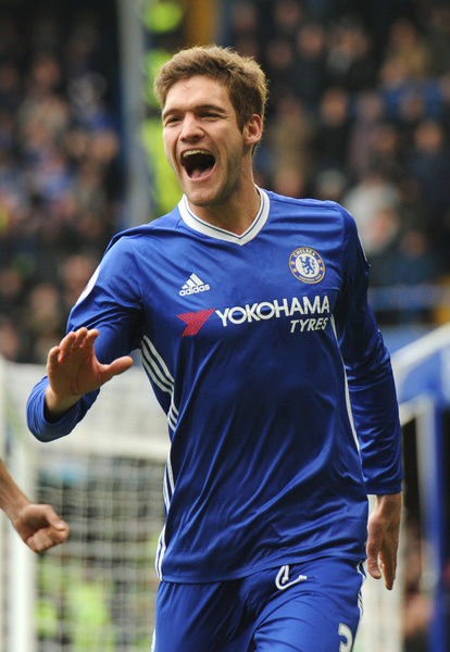 LONDON, ENGLAND - FEBRUARY 04: Marcos Alonso of Chelsea celebrates after scoring the opening goal during the Premier League match between Chelsea and Arsenal at Stamford Bridge on February 4, 2017 in London, England