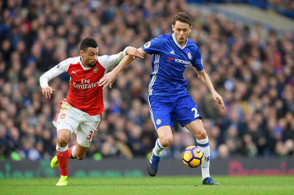 LONDON, ENGLAND - FEBRUARY 04: Nemanja Matic of Chelsea battles for the ball with Francis Coquelin of Arsenal during the Premier League match between Chelsea and Arsenal at Stamford Bridge on February 4, 2017 in London, England