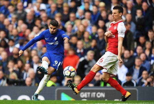 LONDON, ENGLAND - SEPTEMBER 17: Alvaro Morata of Chelsea shoots as Laurent Koscielny of Arsenal attempts to block during the Premier League match between Chelsea and Arsenal at Stamford Bridge on September 17, 2017 in London, England
