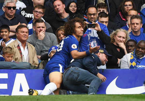 LONDON, ENGLAND - SEPTEMBER 17: David Luiz of Chelsea colides with a fan during the Premier League match between Chelsea and Arsenal at Stamford Bridge on September 17, 2017 in London, England. (Photo by Darren Walsh/Chelsea FC via Getty Images)