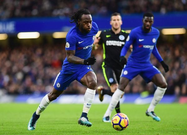 LONDON, ENGLAND - DECEMBER 26: Victor Moses of Chelsea runs with the ball during the Premier League match between Chelsea and Brighton and Hove Albion at Stamford Bridge on December 26, 2017 in London, England