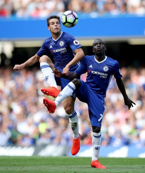 Chelsea's Cesar Azpilicueta (left) and N'Golo Kante (right) both attempt to control the ball during the Premier League match at Stamford Bridge, London