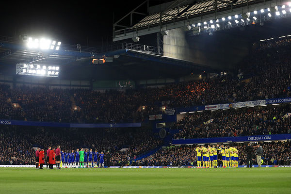 Players observe a minute's silence to mark Remembrance Day during the Premier League match at Stamford Bridge, London