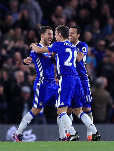 Chelsea's Eden Hazard celebrates scoring his side's fourth goal of the game during the Premier League match at Stamford Bridge, London. PRESS ASSOCIATION Photo. Picture date: Saturday November 5, 2016. See PA story SOCCER Chelsea. Photo credit should read