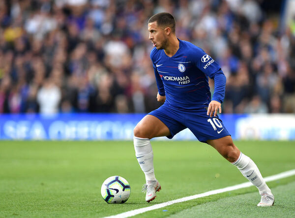 LONDON, ENGLAND - SEPTEMBER 29: Eden Hazard of Chelsea runs with the ball during the Premier League match between Chelsea FC and Liverpool FC at Stamford Bridge on September 29, 2018 in London, United Kingdom