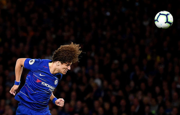 LONDON, ENGLAND - SEPTEMBER 29: David Luiz of Chelsea heads the ball during the Premier League match between Chelsea FC and Liverpool FC at Stamford Bridge on September 29, 2018 in London, United Kingdom