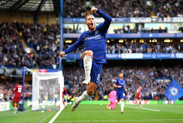 LONDON, ENGLAND - SEPTEMBER 29: Eden Hazard of Chelsea celebrates after scoring his team's first goal during the Premier League match between Chelsea FC and Liverpool FC at Stamford Bridge on September 29, 2018 in London, United Kingdom