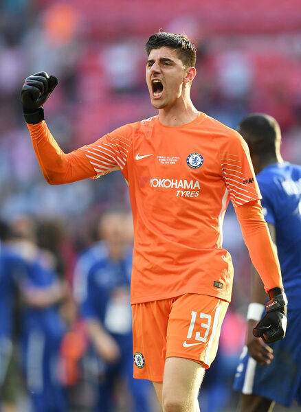 LONDON, ENGLAND - MAY 19: Thibaut Courtois of Chelsea celebrates his sides victory following The Emirates FA Cup Final between Chelsea and Manchester United at Wembley Stadium on May 19, 2018 in London, England