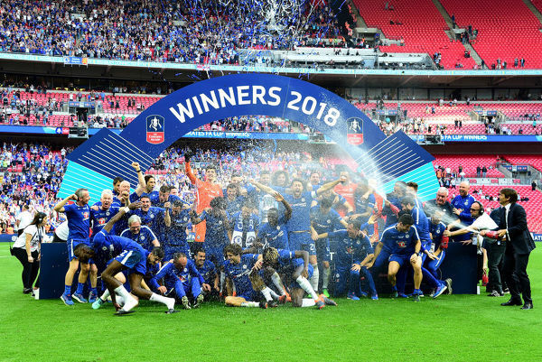 LONDON, ENGLAND - MAY 19: Antonio Conte, Manager of Chelsea sprays his team with Champagne following his sides victory in The Emirates FA Cup Final between Chelsea and Manchester United at Wembley Stadium on May 19, 2018 in London, England