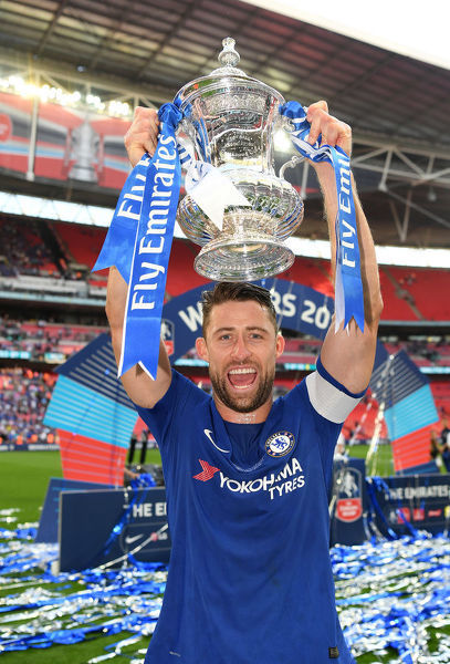 LONDON, ENGLAND - MAY 19: Gary Cahill of Chelsea celebrates with the Emirates FA Cup Trophy following his sides victory in The Emirates FA Cup Final between Chelsea and Manchester United at Wembley Stadium on May 19, 2018 in London, England