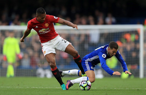 Manchester United's Luis Antonio Valencia and Chelsea's Eden Hazard battle for the ball during the Premier League match at Stamford Bridge, London