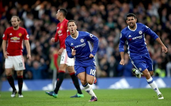 Chelsea's Eden Hazard celebrate scoring his side's third goal of the game with teammate Diego Costa (right) during the Premier League match at Stamford Bridge, London