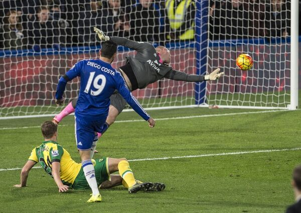 Chelsea's Diego Costa scores their first goal past Norwich City goalkeeper John Ruddy