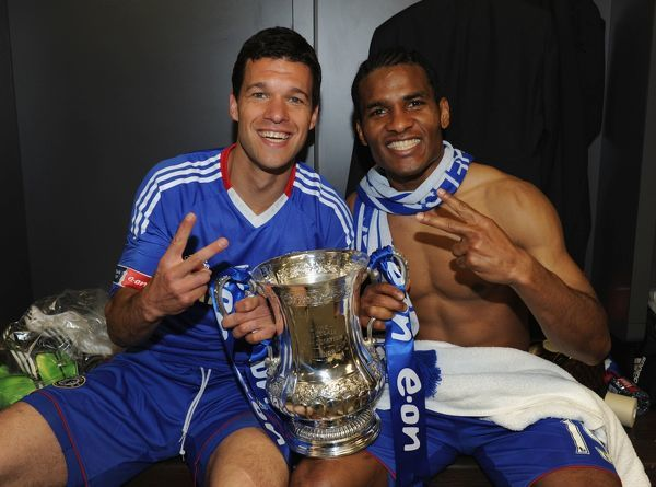 LONDON, ENGLAND - MAY 15: Michael Ballack and Florent Malouda (R) of Chelsea pose with the trophy in the dressing room at the end of the FA Cup sponsored by E.ON Final match between Chelsea and Portsmouth at Wembley Stadium on May 15, 2010 in London