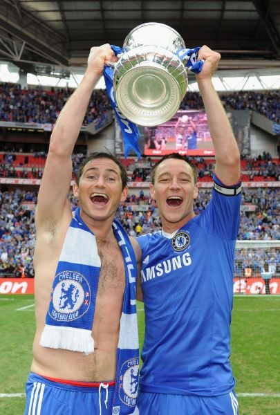 LONDON, ENGLAND - MAY 15: Frank Lampard (R) and John Terry of Chelsea celebrate after winning the FA Cup sponsored by E.ON Final match between Chelsea and Portsmouth at Wembley Stadium on May 15, 2010 in London, England