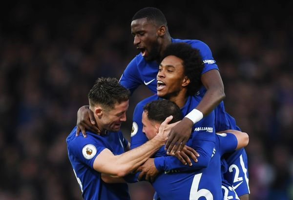 LONDON, ENGLAND - DECEMBER 30: Gary Cahill of Chelsea, Antonio Rudiger and Willian of Chelsea congratulate Danny Drinkwater of Chelsea after he scored his team's second goal during the Premier League match between Chelsea and Stoke City at Stamford