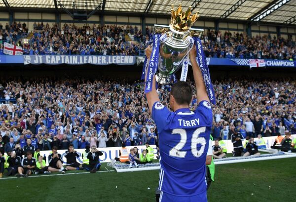 LONDON, ENGLAND - MAY 21: John Terry of Chelsea celebrates with the Premier League Trophy after the Premier League match between Chelsea and Sunderland at Stamford Bridge on May 21, 2017 in London, England