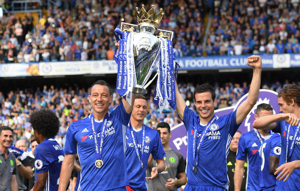 LONDON, ENGLAND - MAY 21: John Terry of Chelsea and Cesar Azpilicueta of Chelsea lift the Premier Leauge Trophy after the Premier League match between Chelsea and Sunderland at Stamford Bridge on May 21, 2017 in London, England
