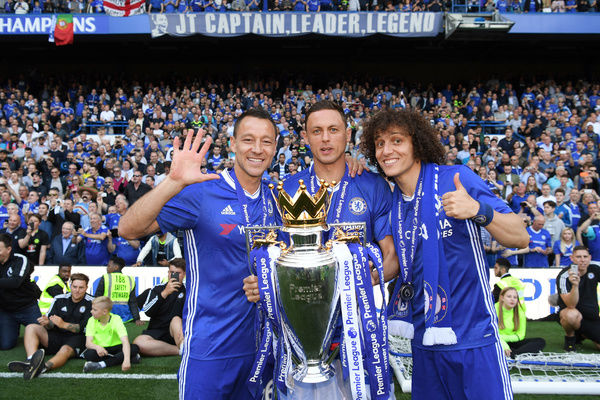 LONDON, ENGLAND - MAY 21: (L-R) John Terry of Chelsea, Nemanja Matic of Chelsea and David Luiz of Chelsea pose with the Premier League Trophy after the Premier League match between Chelsea and Sunderland at Stamford Bridge on May 21, 2017 in London, England