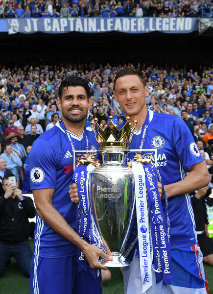 LONDON, ENGLAND - MAY 21: Diego Costa of Chelsea and Nemanja Matic of Chelsea pose with the Premier League Trophy after the Premier League match between Chelsea and Sunderland at Stamford Bridge on May 21, 2017 in London, England