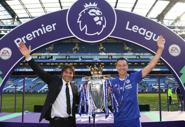 LONDON, ENGLAND - MAY 21: Antonio Conte, Manager of Chelsea and John Terry of Chelsea pose with the Premier League Trophy after the Premier League match between Chelsea and Sunderland at Stamford Bridge on May 21, 2017 in London, England