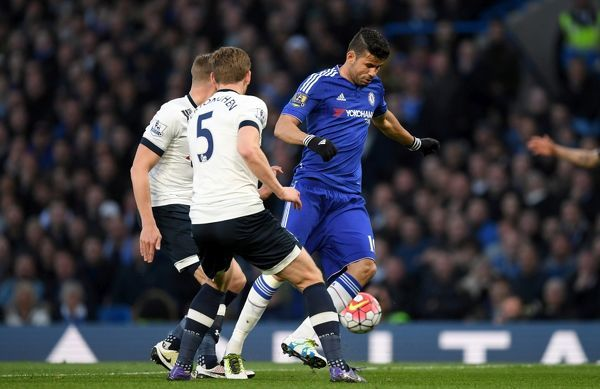Chelsea's Diego Costa and Tottenham Hotspur's Jan Vertonghen (5) battle for the ball