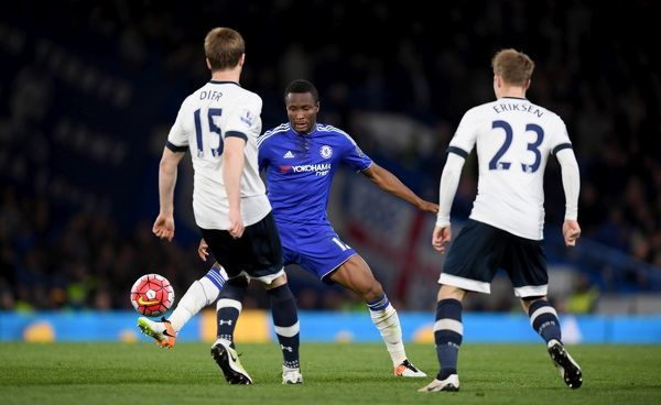 Tottenham Hotspur's Eric Dier (left) and Christian Eriksen (right) battle for the ball with Chelsea's John Obi Mikel