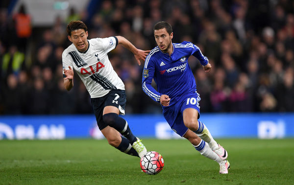 Chelsea's Eden Hazard (right) and Tottenham Hotspur's Son Heung-Min battle for the ball