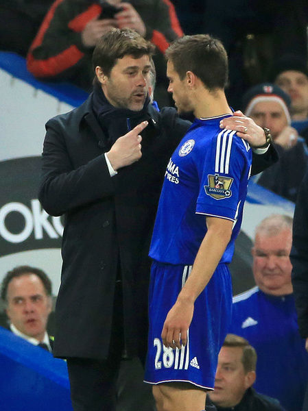 Tottenham Hotspur manager Mauricio Pochettino (left) speaks with Chelsea's Cesar Azpilicueta during the Barclays Premier League match at Stamford Bridge, London