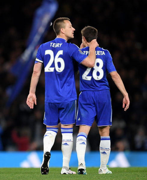 Chelsea's John Terry (left) and Cesar Azpilicueta celebrate the draw after the match