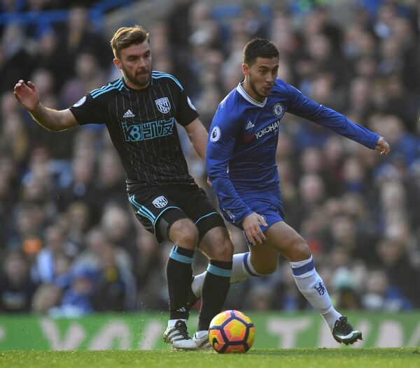 LONDON, ENGLAND - DECEMBER 11: Eden Hazard of Chelsea and James Morrison of West Bromwich Albion compete for the ball during the Premier League match between Chelsea and West Bromwich Albion at Stamford Bridge on December 11, 2016 in London, England