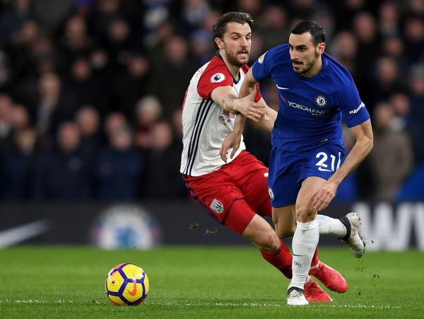LONDON, ENGLAND - FEBRUARY 12: Davide Zappacosta of Chelsea is challenged by Jay Rodriguez of West Bromwich Albion during the Premier League match between Chelsea and West Bromwich Albion at Stamford Bridge on February 12, 2018 in London, England