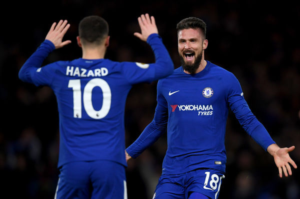 LONDON, ENGLAND - FEBRUARY 12: Eden Hazard of Chelsea celebrates after scoring his sides first goal with Olivier Giroud of Chelsea during the Premier League match between Chelsea and West Bromwich Albion at Stamford Bridge on February 12, 2018 in London