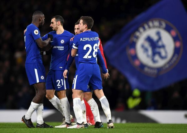 LONDON, ENGLAND - FEBRUARY 12: Eden Hazard of Chelsea celebrates after scoring his sides third goal with his team mates during the Premier League match between Chelsea and West Bromwich Albion at Stamford Bridge on February 12, 2018 in London, England