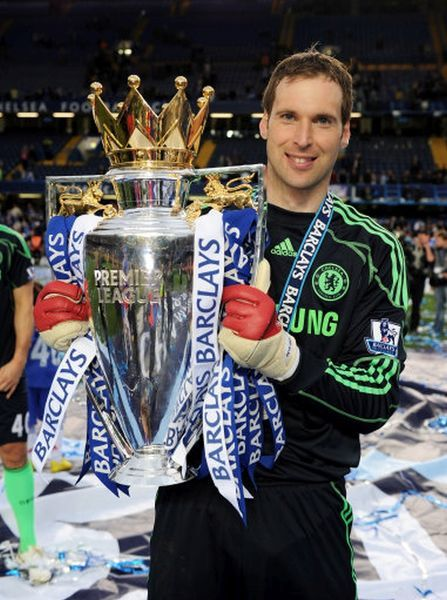LONDON, ENGLAND - MAY 09: Chelsea's Petr Cech celebrates with the trophy after winning the league with an 8-0 victory during the Barclays Premier League match between Chelsea and Wigan Athletic at Stamford Bridge on May 9, 2010 in London, England