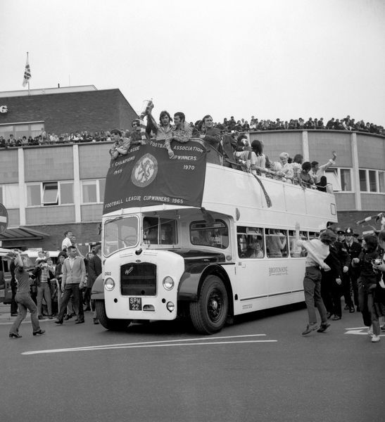 Chelsea celebrate winning the European Cup Winners Cup with fans from the top of an open top bus after victory over Real Madrid. Chelsea's Alan Hudson holds the Cup, with (L-R) Peter Houseman, Marvin Hinton, Keith Weller and Captain Ron Harris
