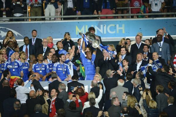 MUNICH, GERMANY - MAY 19: Didier Drogba of Chelsea lift the trophy with the team while celebrate winning the UEFA Champions League Final between FC Bayern Muenchen and Chelsea at the Fussball Arena München on May 19, 2012 in Munich, Germany