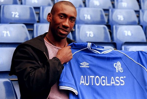 This picture may only be used within the context of an editorial feature. Dutch striker Jimmy Floyd Hasselbaink with a Chelsea shirt at Chelsea's Stamford Bridge ground after the London club announced his transfer from the Spanish club Atletico Madrid