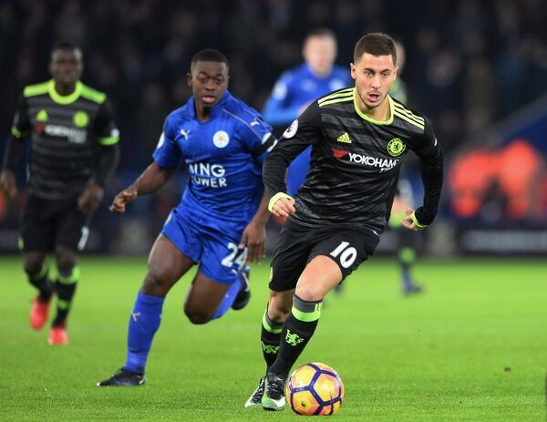 LEICESTER, ENGLAND - JANUARY 14: Eden Hazard of Chelsea is pursued by Nampalys Mendy of Leicester City during the Premier League match between Leicester City and Chelsea at The King Power Stadium on January 14, 2017 in Leicester, England